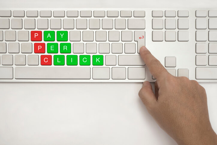 Pay Per Click (PPC) written on keyboard keys in green and red